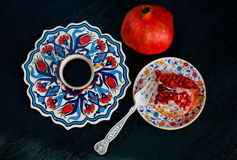 Pomegranate fruit and fresh coffee. Breakfast in traditional style. Stock Images