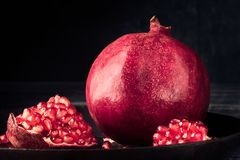 Pomegranate fruit grain red Still life rural rustic style royalty free stock image