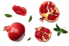 Pomegranate fruit with green leaves isolated on a white background top view royalty free stock image