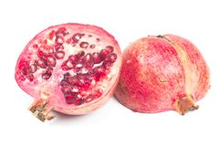 Pomegranate fruit half isolated on white Stock Photos