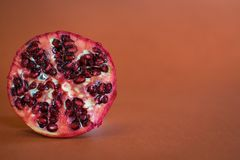 Pomegranate fruit on half royalty free stock photos