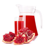 Pomegranate fruit juice in glass pitcher Royalty Free Stock Photos