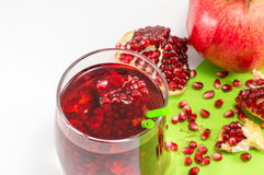 Pomegranate fruit and juice for healthy summer refreshment Royalty Free Stock Photos