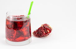 Pomegranate fruit and juice for healthy summer refreshment. Pomegranate fruit and homemade juice for a healthy summer refreshment Stock Photography