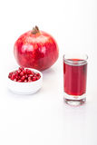 Pomegranate fruit and juice. Ripe pomegranate fruit and its juice Stock Photo