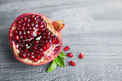 Pomegranate fruit. Juicy pomegranate fruit over wooden vintage table Royalty Free Stock Images