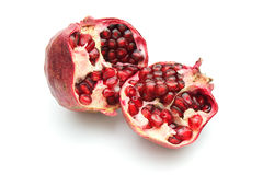 Pomegranate Fruit, Opened. Cut pomegranate fruit with seeds royalty free stock photography