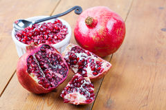 Pomegranate fruit and pips in bowl Stock Photo