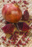 Pomegranate fruit Punica granatum with autumn colors. Clouse up Stock Photos