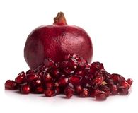 Pomegranate fruits on a white background Royalty Free Stock Images