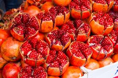 Pomegranate fruit / Ruby red, delicious and nutrient rich pomegr Stock Photos