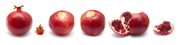Pomegranate fruit  segmenting sequence  isolated on white Royalty Free Stock Photo
