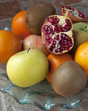 Pomegranate on fruits. Half spread pomegranate on fruits in a plate Royalty Free Stock Photography