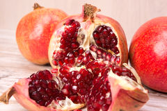 Pomegranate fruits and grains Stock Image