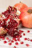 Pomegranate fruits and grains Stock Photography