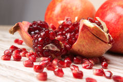 Pomegranate fruits and grains Royalty Free Stock Images