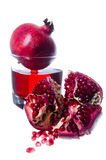 Pomegranate fruits and juice. Isolated on white background Stock Photography