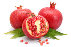 Pomegranate fruits with leaf and cuts isolated Stock Photo