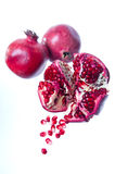 Pomegranate fruits on white background. Focus on first Stock Images