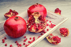 Pomegranate fruits on a white wooden background Stock Photo