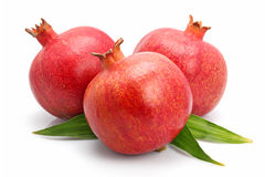 Pomegranate Fruits With Green Leaf Isolated Stock Photo