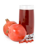 Pomegranate and garnet juice in a glass. Royalty Free Stock Images