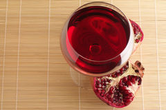 Pomegranate and glass of red wine. Stock Photo
