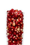 Pomegranate in glass on white. Background stock images