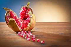 Pomegranate and grains Royalty Free Stock Photography