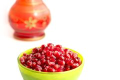 Pomegranate grains in a cup, juice royalty free stock photos
