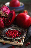 Pomegranate granules on silver plate in oriental style Stock Image