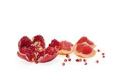 Pomegranate and grapefruit Stock Photos