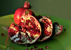 Pomegranate on green dish Stock Image