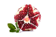 Pomegranate with green leaf Stock Image
