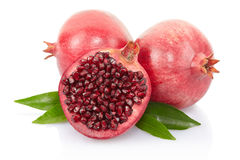 Pomegranate and half with leaves Stock Photo