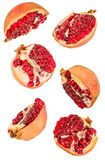 Pomegranate halves flying isolated on white background with clipping path stock photos