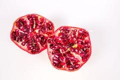 Pomegranate halves. Pomegranates halves isolated on w white background Royalty Free Stock Photography