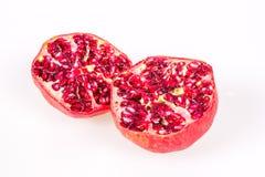 Pomegranate halves. Pomegranates halves isolated on w white background Royalty Free Stock Photos