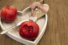 Pomegranate with heart cutout Royalty Free Stock Photography