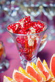 Pomegranate on the holiday table. Royalty Free Stock Image