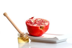 Pomegranate and honey Stock Images