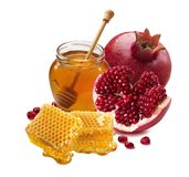 Pomegranate, honey jar and honeycomb isolated on white background stock photo