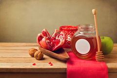 Pomegranate and honey for Rosh Hashanah holiday. Jewish New Year. Stock Photos