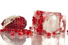 Pomegranate in ice Stock Photography