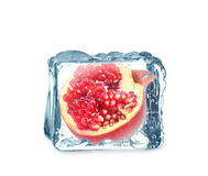 Pomegranate in the ice cube stock photography