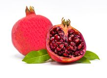 Pomegranate isolated on white background,pomegranate leaves and sliced royalty free stock image