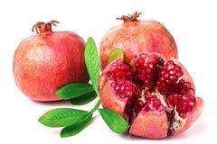 Pomegranate isolated on white background. Three pomegranate isolated on white background royalty free stock photography