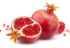 Pomegranate isolated on white background. Pomegranate isolated. Whole pomegranate and its half isolated on white background with clipping path Royalty Free Stock Photos