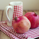 Pomegranate and jug Royalty Free Stock Photos