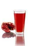 Pomegranate juice. Fresh half of pomegranate and juice Royalty Free Stock Photography